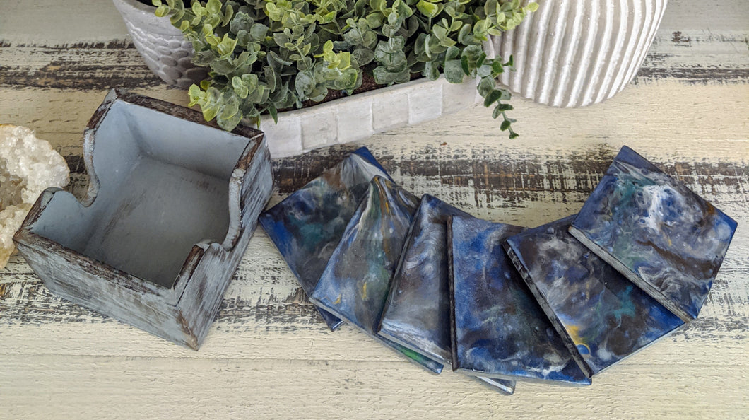 6 wood coasters with blue grey resin and holder