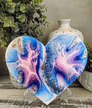 abstract blue pink resin heart with fire glass