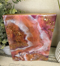vibrant abstract resin art in orange white purple with crystals