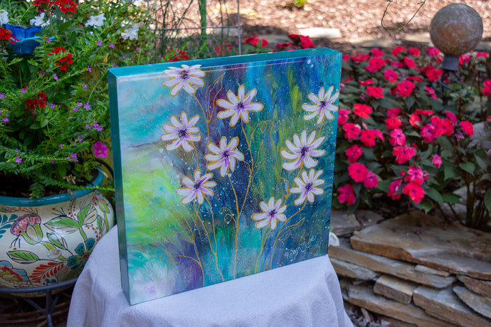 abstract fluid acrylic white daisy painting with texture and vibrant blue colors