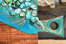 wood cheese board green resin art stones close up