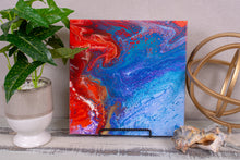 abstract fluid acrylic painting with texture and vibrant rainbow colors
