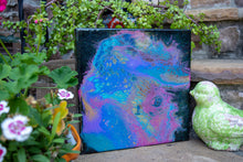 abstract fluid acrylic painting with texture and vibrant teal lavender magenta colors
