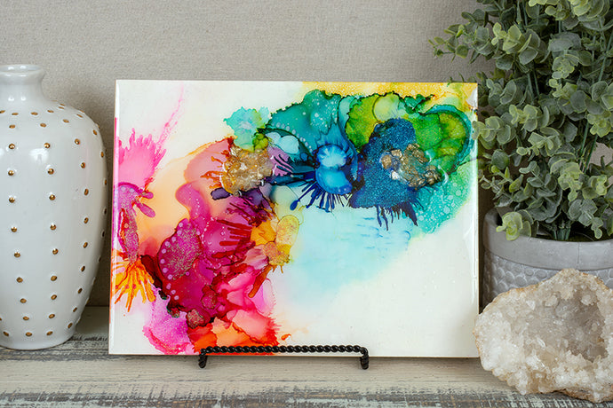 abstract splashes of rainbow colored alcohol ink