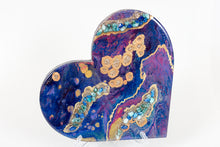 Abstract blue purple magenta heart with blue stones