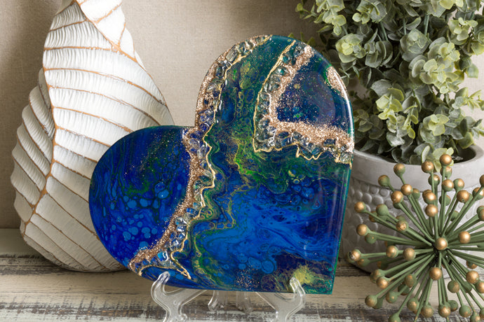abstract blue green heart with stones