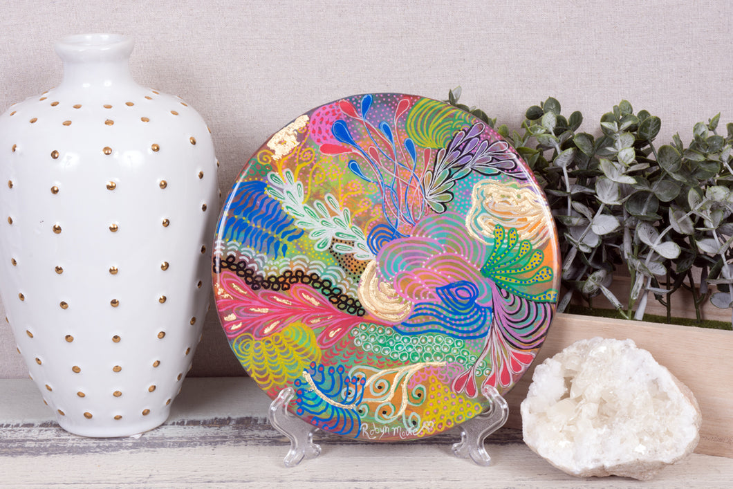 abstract rainbow colors of acrylic paint underwater coral round resin wood