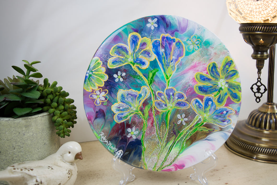 flowers layered on top of rainbow watercolor background round wood
