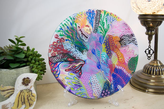 abstract rainbow colors of acrylic paint underwater coral round wood