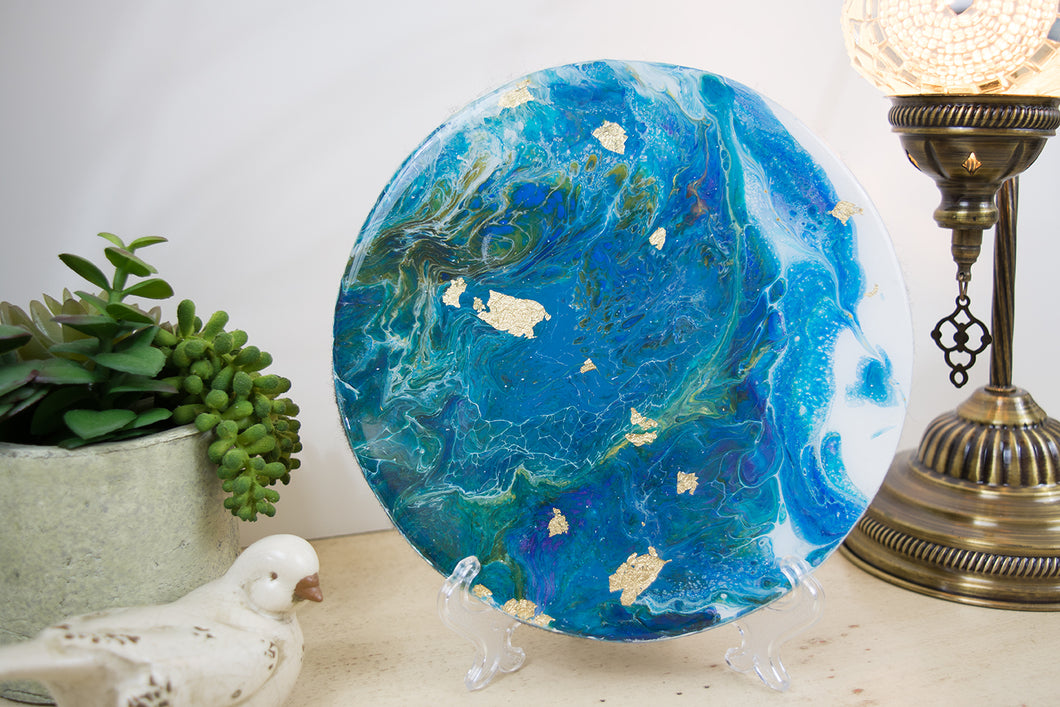 vibrant abstract flowing ocean looking blue fluid painting with gold leaf