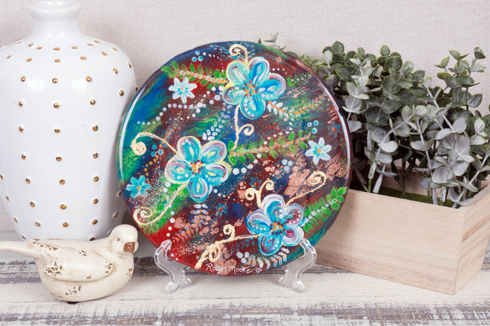 vibrant abstract background with daisies round resin painting