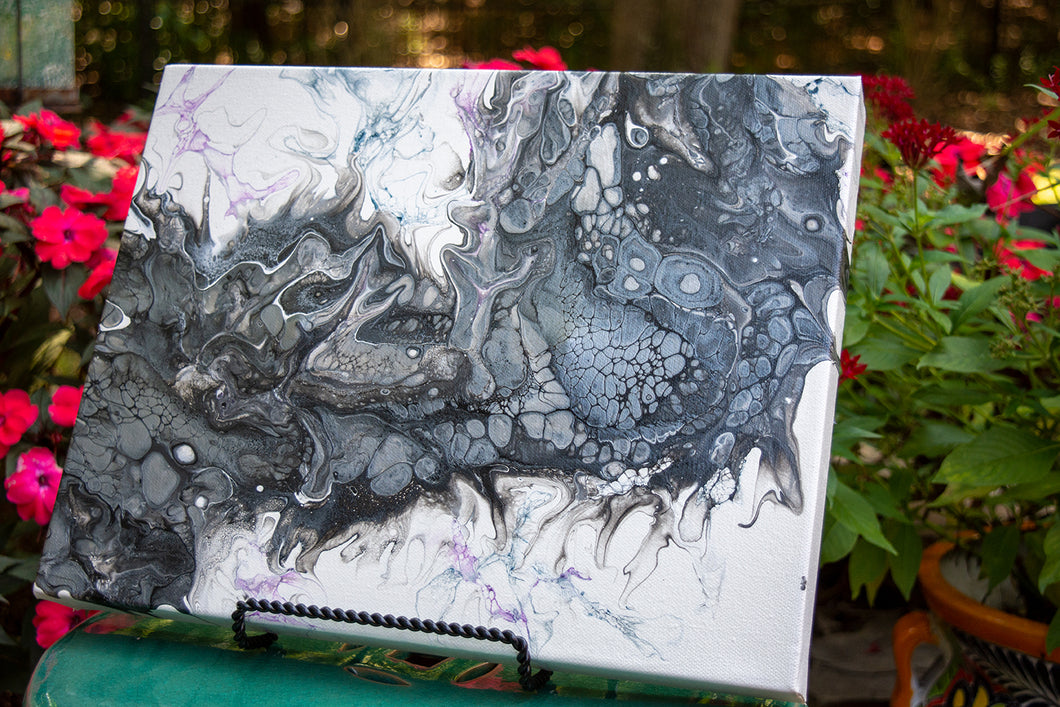abstract fluid acrylic painting with texture and black and silver colors