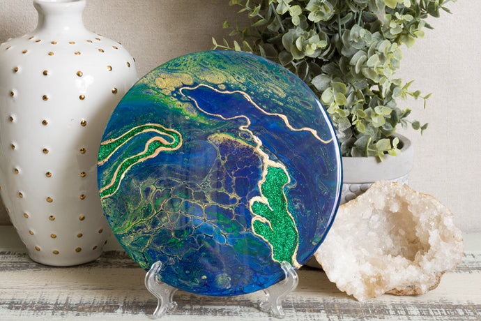 abstract fluid resin trivet with vibrant blue green gold colors