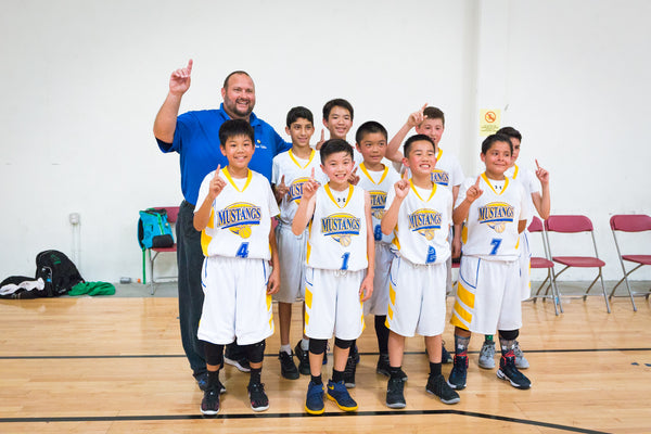 Mesa Robles 6th grade team and coach hold up the number one sign after winning the tournament