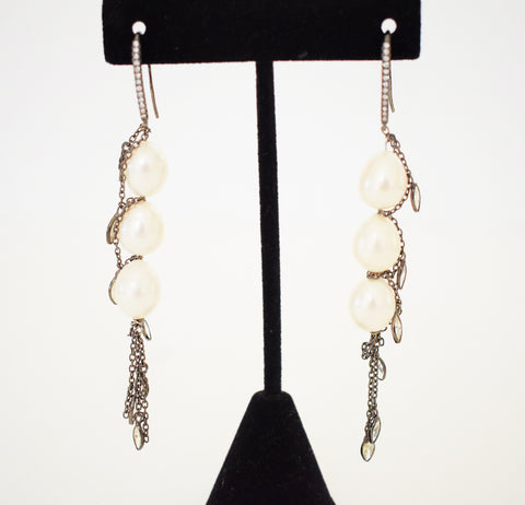 Oval pearl earrings with dangling CZs