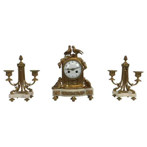 Small French marble and ormolu garniture set clock and candelabra. Vincenti et Cie