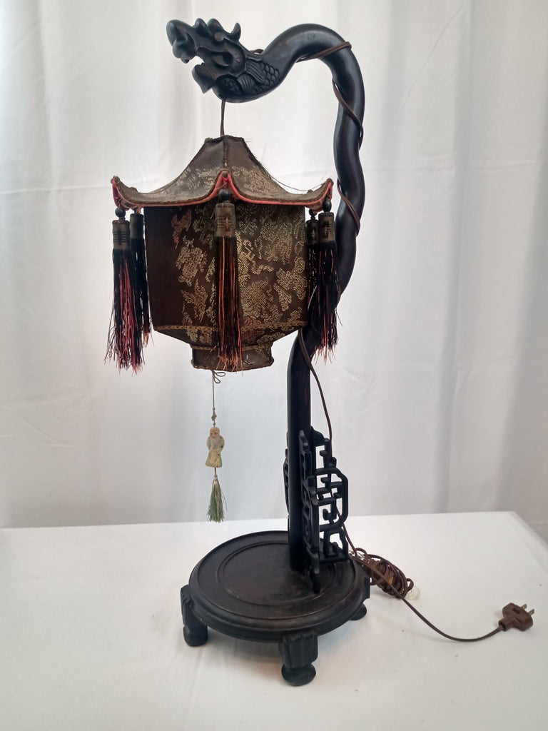 Republic Period Chinese Dragon Tasseled Table Lamp with Covered Wood and Loomed porcelain Figure.