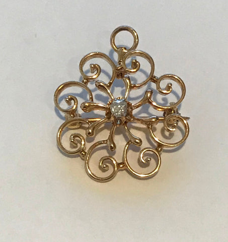 Pendant Brooch. 14k Yellow Gold Swirl with .15 ct Center Diamond