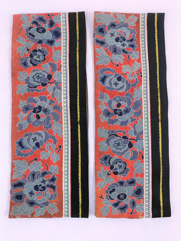 "Pair of sleeves. Chinese embroidery on silk. Flowers and Buddhist symbols on red ground. Peking knot, forbidden stitch. Beige ground.  14.5"" by 6"""