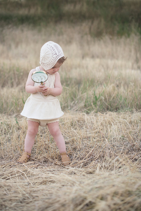 Organic cotton knit tutu and lace baby bonnet in cream