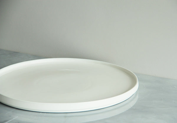 Large, round platter. Worthy of an entrance at any dinner party. Loves to play with fruit or cheese and crackers.