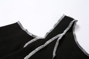 'Outcast' Black cold shoulder top with patchwork stitching detail