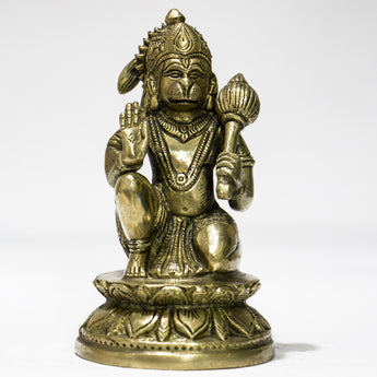 Brass idol of Lord Hanuman sitting