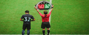 Linesman holding the board for a substitution at a Football match.