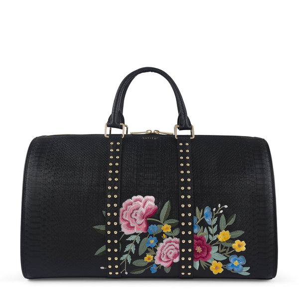 Front view of Latitu° Jardin de København holdall in black with floral embroidery