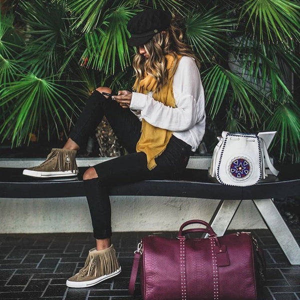 Instagram | @audriestorme sitting on bench next to burgundy Latitu° København holdall