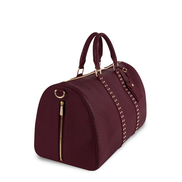 Left side view of Latitu° København holdall in burgundy
