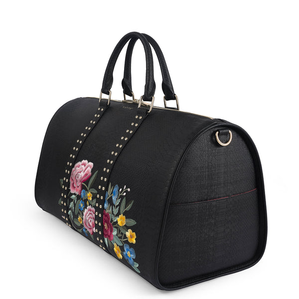 Right side view of Latitu° Jardin de København holdall in black with floral embroidery