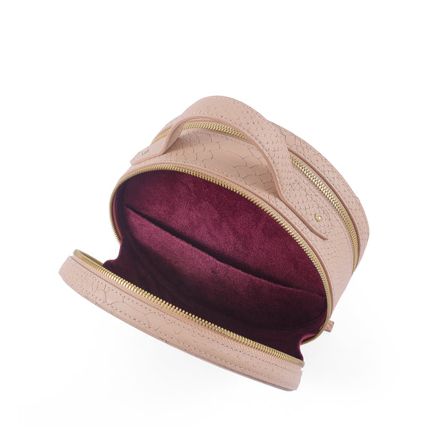 Three quarter back view of Latitu° Formosa handbag in camel, with burgundy contrast lining