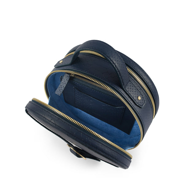 Three quarter view of Latitu° Formosa handbag in navy blue, with sky blue contrast lining