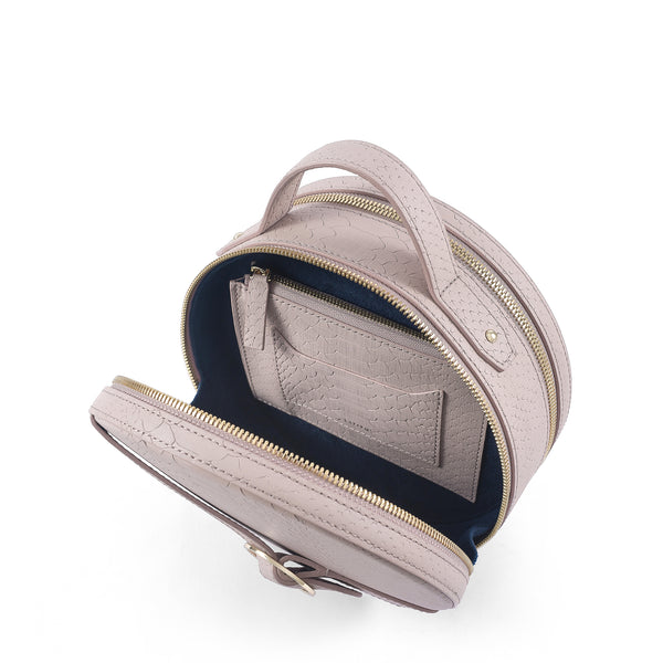 Three quarter view of Latitu° Formosa handbag in warm taupe, with navy blue contrast lining