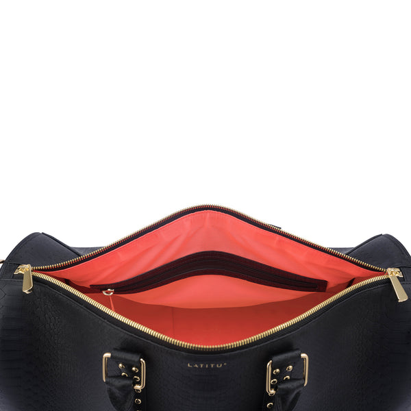 Birds eye view of Latitu° København holdall in black, with coral contrast lining