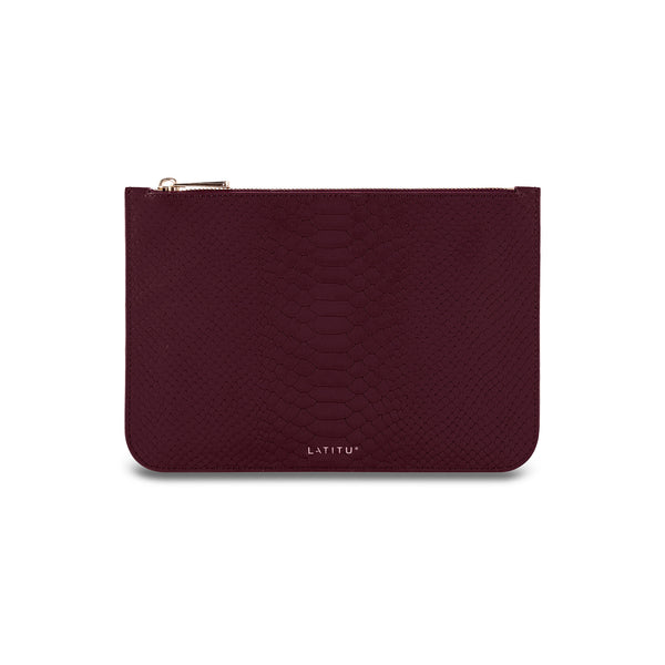 Front view of Latitu° removable leather clutch in burgundy