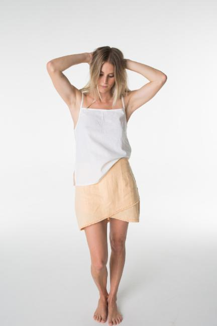 Linen blend lenni tie top. Peach linen skirt with fringing.