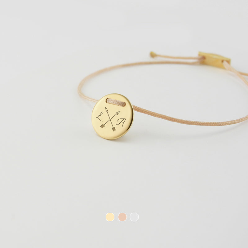 Delicate and handmade lucky charm bracelets. Tell your story on a piece of personalized jewelry with a meaningful message, monogram, special symbol or a significant date. This collection features an array of personalized disk bracelets. Every piece is made to order.