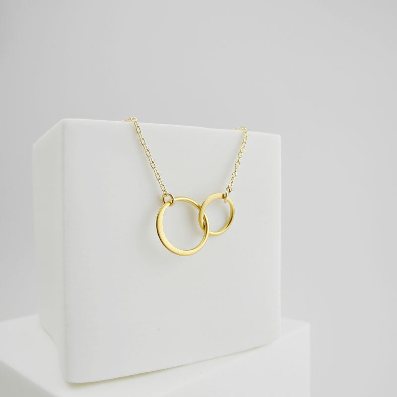 The circle pendants represent infinity, a powerful symbol of continuous connection, love, life, grace and energy.