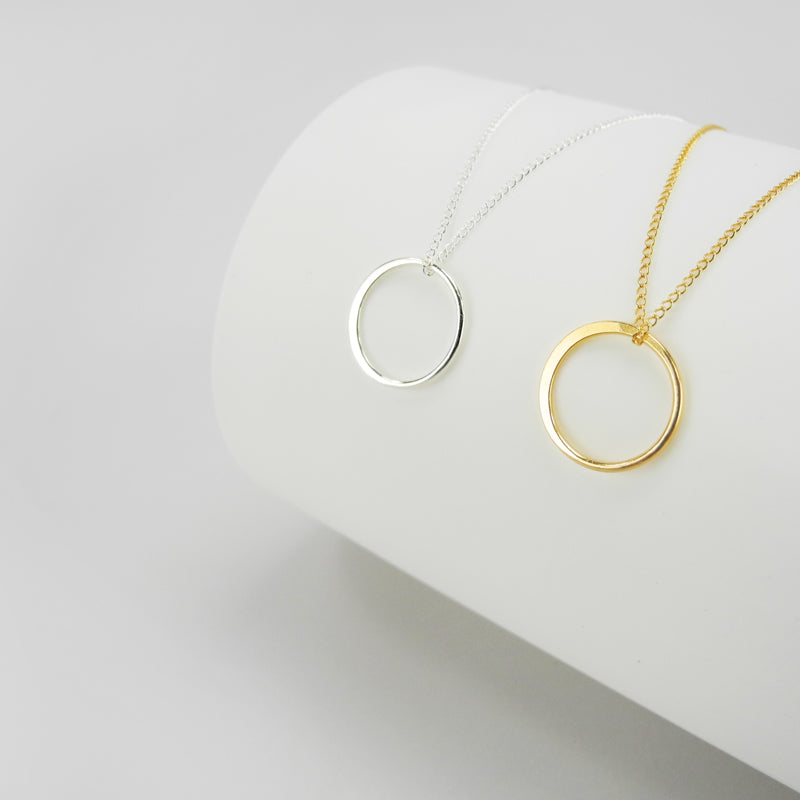 The circle pendant represents infinity, a powerful symbol of continuous connection, love, life, grace and energy. Classic and captivating, this circle pendant is striking in its simplicity. The circle has been flattened on one side and is shiny polished.