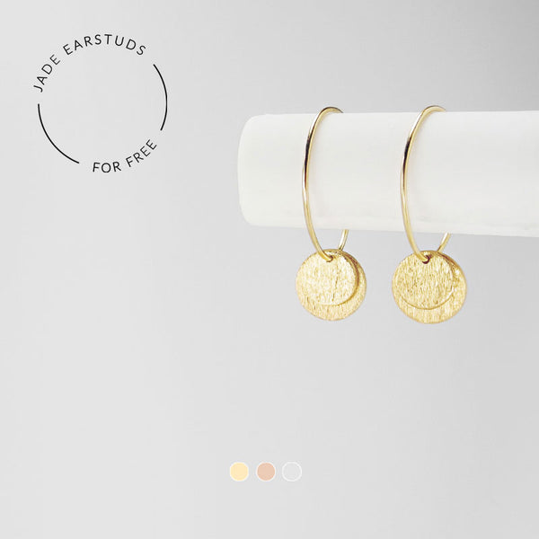 Very delicate small hoops with a combination of big and small disk pendants. These earrings effortlessly blend timeless style with an elegant inscription.
