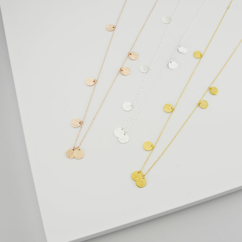 Playful and classic, the j&j collection shines with graphic sophistication and bold simplicity. Delicate round pendants alternate along link chains to create a stunning effect.