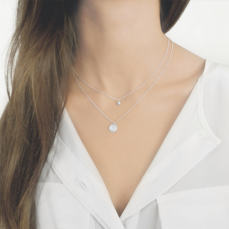 This collection is a delicate layering collection, defined by sleek curves and contours. The classic and captivating forms of the pendants and the delicate chains are a modern interpretation of the classic jewelry design.