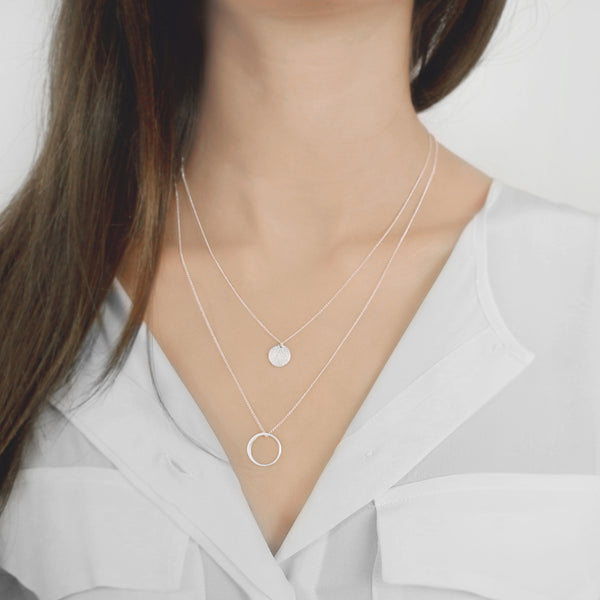 This collection is a delicate layering collection, defined by sleek curves and contours. The classic and captivating forms of the pendants and the delicate chains are a modern interpretation of the classic jewelry design. The variety of lengths and pendants creates endless possibilities for combinations which enable you to find a different look each day.