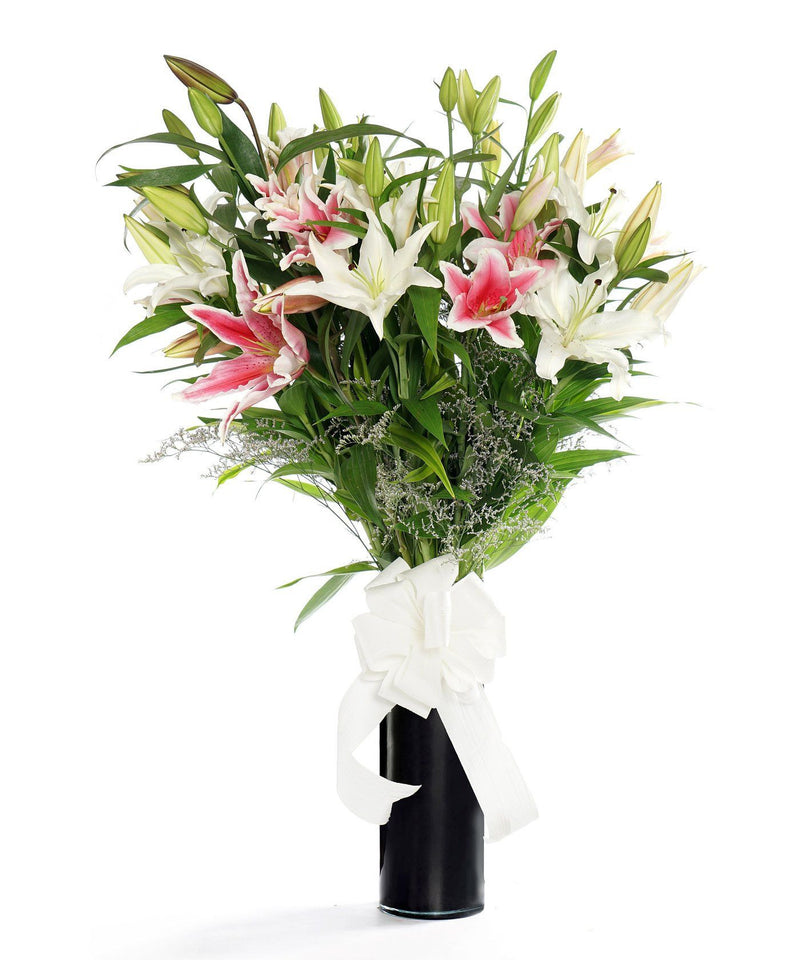 mixed colour oriental lilies.