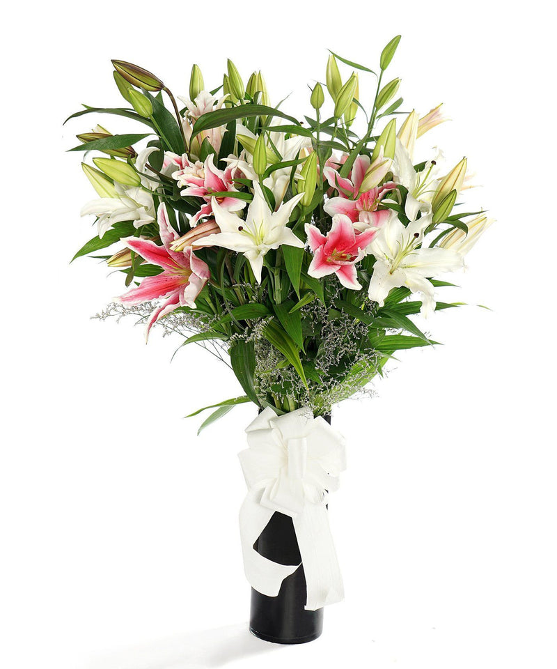 Assorted Oriental Lilies (White & Pink in a Vase)