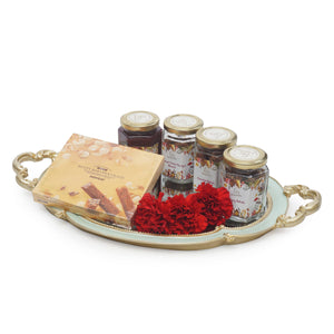 Mirror gift tray with walnuts, almonds and carnations