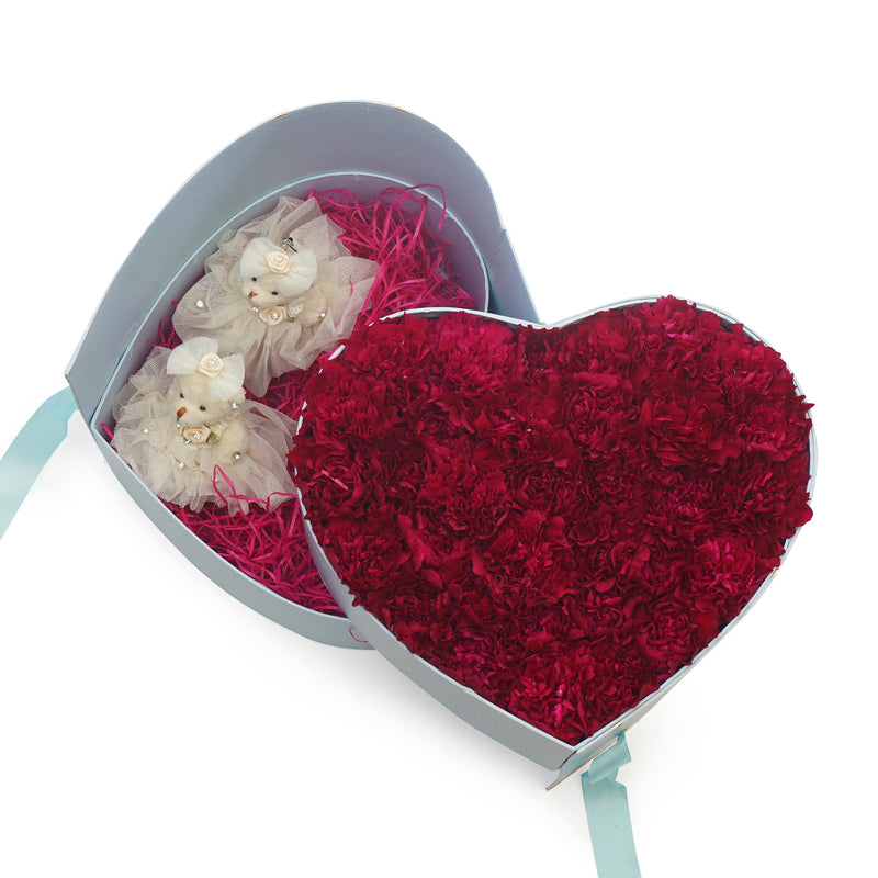 carnations in a heart shaped container