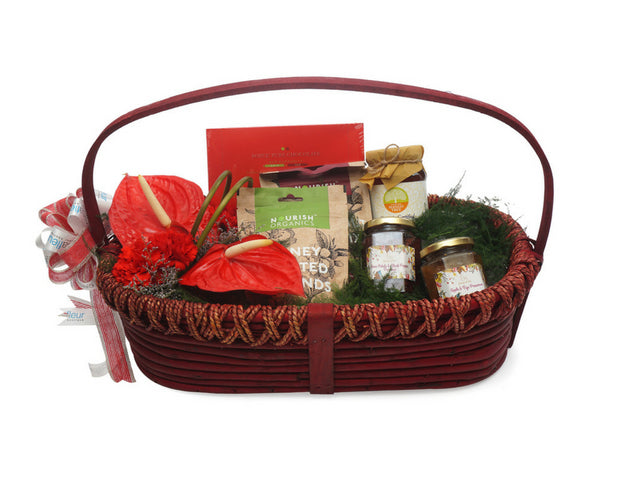 Brown gift basket with anthuriums & carnations